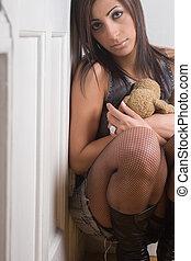 Fashion model - Holding teddy bear - Twenty something model...
