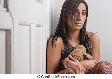 Sad and Hugging teddy - Twenty something fashion model...