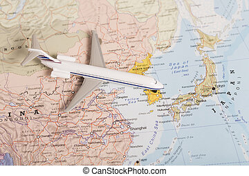 Travel destination Japan. Passenger plane miniature over the map