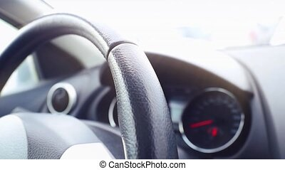 Interior view of car with black salon, speedometer and...