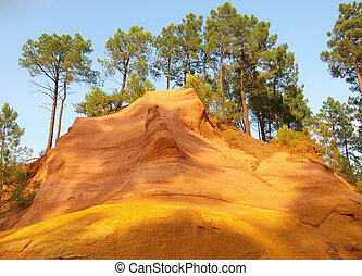 Ochre cliffs and pine trees