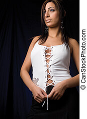 Adjusting knot - Twenty something fashion model in sexy...