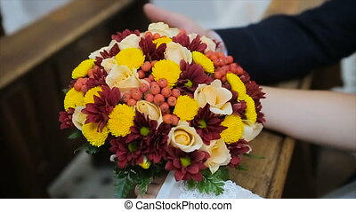 Bridal bouquet of flowers in hands
