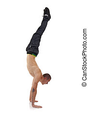 hand stand - young breakdancer in move against grey...