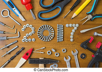 Happy new year 2017 composition with screws, nails, bolts ,...