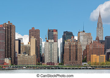 Manhattan skyline with Chrysler Building View from Queens...