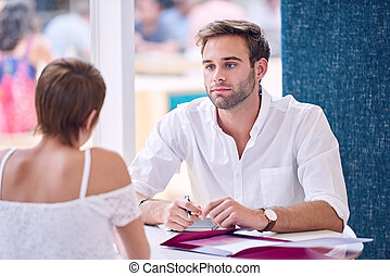 Businessman paying attention to his female partner during...