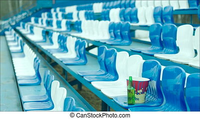 Empty tribune with a bottle and popcorn bucket only - Clip...