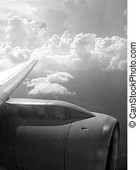 airplane reactor sky view from aircraft black and white