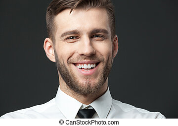 Portait of handsome young businessman smiling with...