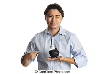 Handsome man with piggy bank - An attractive man in a light...