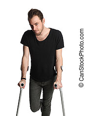 Man with crutches - Man wearing a black t-shirt and jeans...