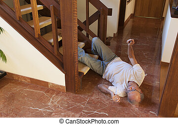 Senior man fell down the stairs on a marble floor