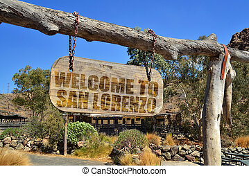 "old vintage wood signboard with text "" welcome to San..."