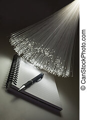 Writing pad and pen and optical fiber floodlight.