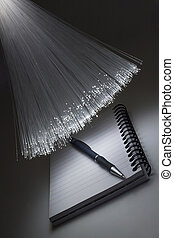 Writing pad and pen and optical fiber floodlight