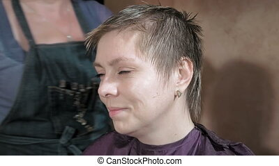 Hairdresser cuts combs and styles woman's hair - Hairdresser...