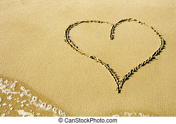 heart in the sand - a heart drawn on the sand of the beach