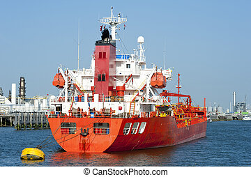 Oil Tanker - Moored oil tanker in an industrial harbor near...