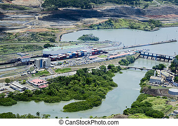 Aerial view of Miraflores Locks. Cargo ships passing through...