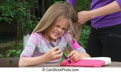 Girl hurt when my mother combing her long tangled hair