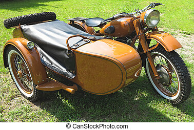 vintage motorcycle with sidecar parked on grass - vintage...
