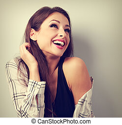 Happy casual toothy laughing woman in shirt looking up Toned...
