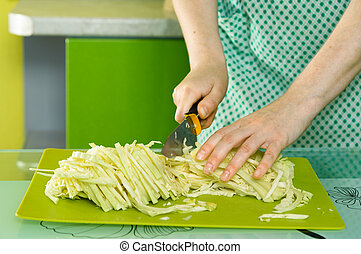 womens hands cut the cabbage on green chalkboard - womens...