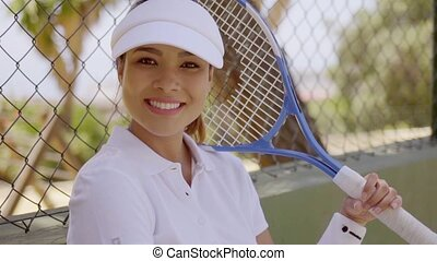 Smiling Young Tennis Player Resting in Shade - Head and...