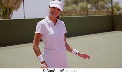 Female Tennis Player with Racket on Sunny Court - Waist Up...
