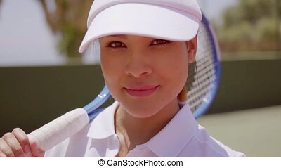 Female Tennis Player with Racket Wearing Sun Visor - Close...