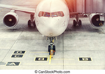 Airplane ready for boarding in a airport hub