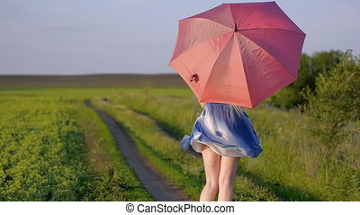 portrait of a beautiful girl with a red umbrella in the...