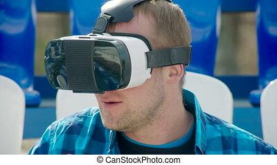 Happy guy in VR glasses - Man in VR glasses eating popcorn,...