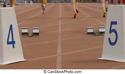 group women athletes start and run at sprint competitions at...