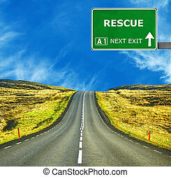RESCUE road sign against clear blue sky