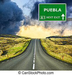 PUEBLA road sign against clear blue sky