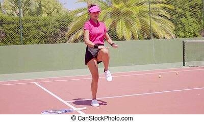Young woman warming up before tennis match - Young...