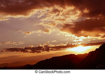 golden orange brown sunset sky clouds with sun