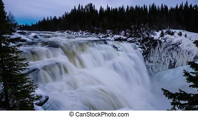 Timelapse of Sweden Tannforsen waterfall in winter time,