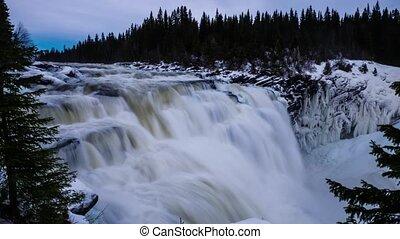 Timelapse of Sweden Tannforsen waterfall in winter time,