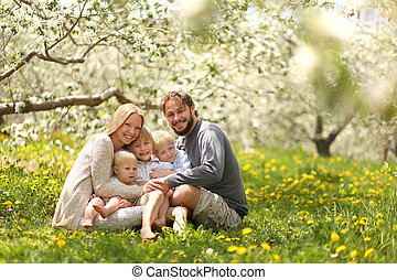Happy Family of Five Portrait in Spring Flower Meadow - A...