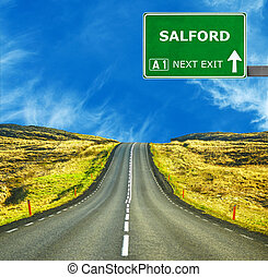 SALFORD road sign against clear blue sky