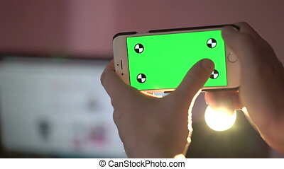 Close Up Man Holding Smartphone Touch Screen With Green...