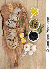 Mediterranean Olive Bread - Olive bread on a wooden board...