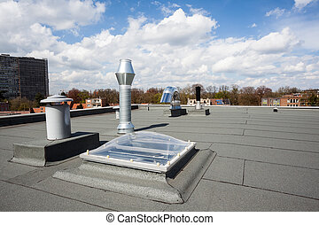Chimney on the roof - inox Chimney on the flat roof in the...