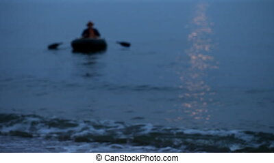 Sea, rubber boat, dawn, fishing - A fisherman floating in...