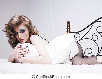 crying blonde woman laying in bed depressed - crying woman...