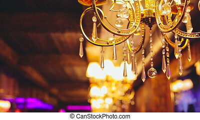 Gold chandelier with crystal balls in full HD