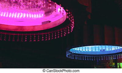Colorful chandelier with crystal in the night club in full...